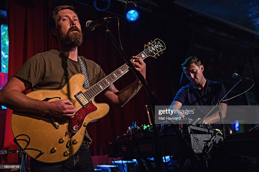 Singer/guitarist Matt Pelham (L) and keyboard player Mark Bond (R) of the Features perform during an EndSession hosted by 107.7 The End at the J&M Cafe on September 29, 2013 in Seattle, Washington.