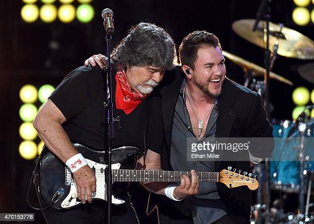 Singer/guitarist Randy Owen of Alabama and frontman Mike Eli of the Eli Young Band perform onstage during ACM Presents Superstar Duets at Globe Life...