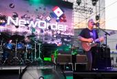Singer/musician Bernard Sumner of New Order performs at Williamsburg Park on July 24 2013 in Brooklyn New York