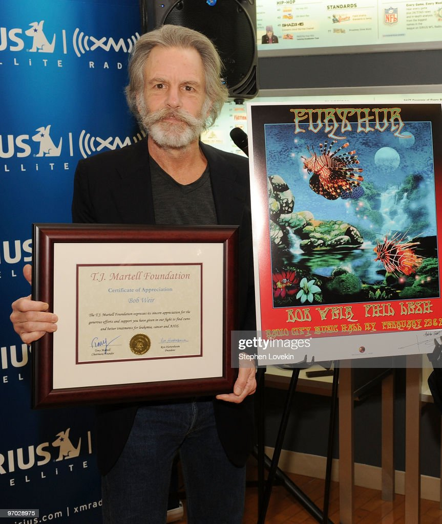Singer/musician Bob Weir receives a plaque for his support at SIRIUS XM Studio on February 24, 2010 in New York City.