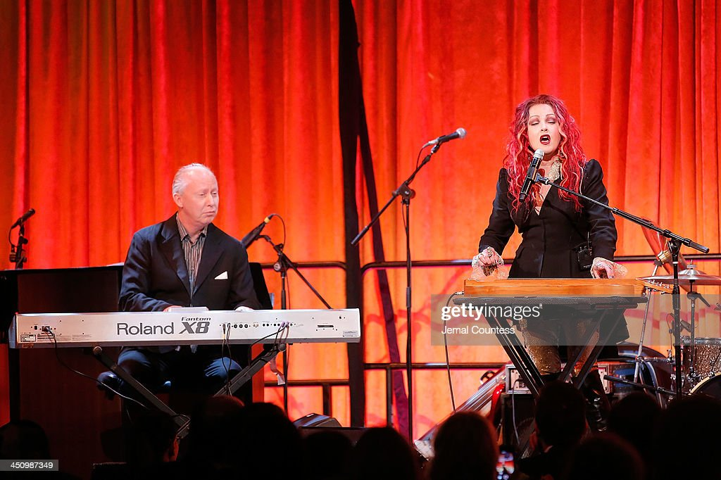 Singer/musician <a gi-track='captionPersonalityLinkClicked' href=/galleries/search?phrase=Cyndi+Lauper&family=editorial&specificpeople=171290 ng-click='$event.stopPropagation()'>Cyndi Lauper</a> (R) performs at the 2013 Silver Hospital gala at Cipriani 42nd Street on November 20, 2013 in New York City.