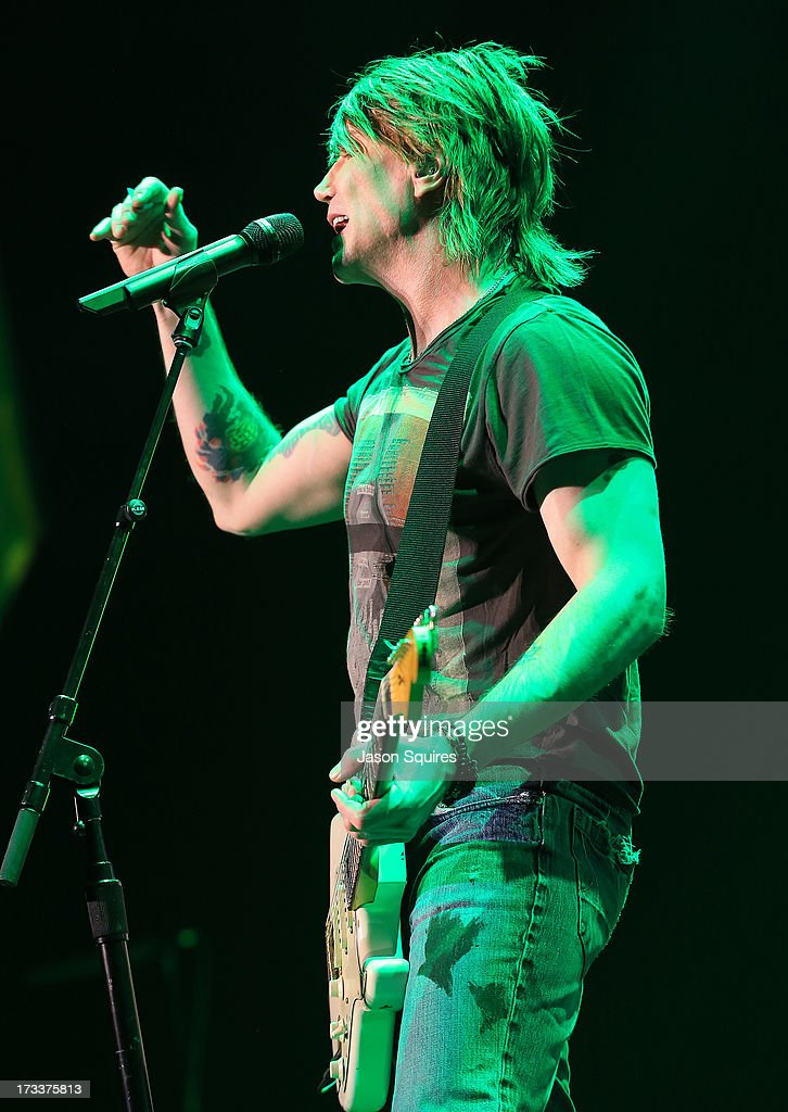 Singer/musician <a gi-track='captionPersonalityLinkClicked' href=/galleries/search?phrase=John+Rzeznik&family=editorial&specificpeople=220876 ng-click='$event.stopPropagation()'>John Rzeznik</a> of Goo Goo Dolls performs at Sprint Center on July 12, 2013 in Kansas City, Missouri.