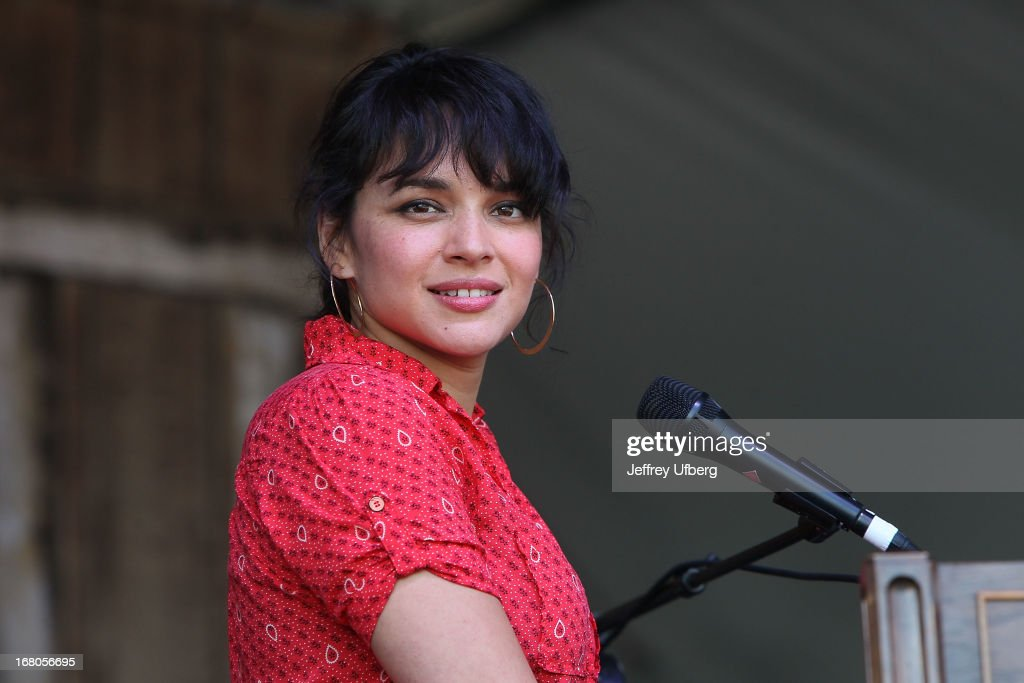 Singer/musician <a gi-track='captionPersonalityLinkClicked' href=/galleries/search?phrase=Norah+Jones&family=editorial&specificpeople=203151 ng-click='$event.stopPropagation()'>Norah Jones</a> performs during the 2013 New Orleans Jazz & Heritage Music Festival at Fair Grounds Race Course on May 4, 2013 in New Orleans, Louisiana.