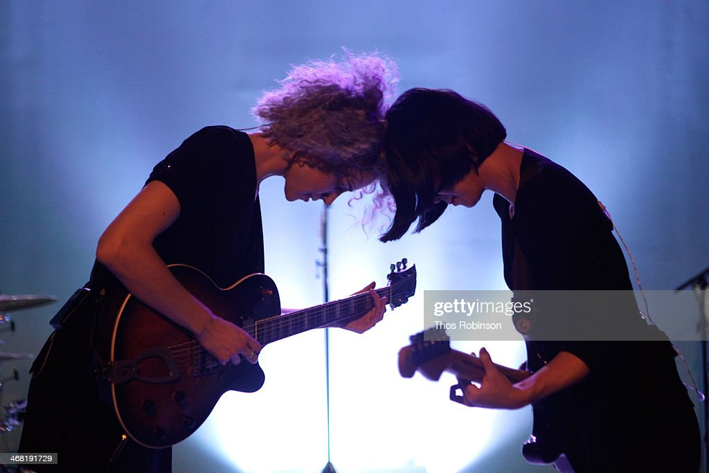 Singer/musician St. Vincent (L) and guitarist/mini moog player Toko Yasuda perform at the American Express UNSTAGED Fashion with DVF at Spring Studios on February 9, 2014 in New York City.