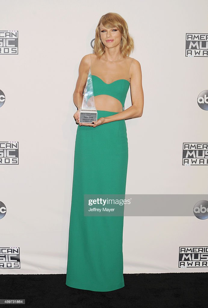 Singer/musician Taylor Swift poses in the press room at the 2014 American Music Awards at Nokia Theatre L.A. Live on November 23, 2014 in Los Angeles, California.