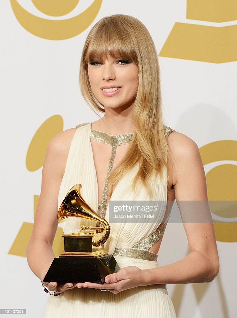 Singer/Musician Taylor Swift, winner of Best Song Written For Visual Media, poses in the press room at the 55th Annual GRAMMY Awards at Staples Center on February 10, 2013 in Los Angeles, California.