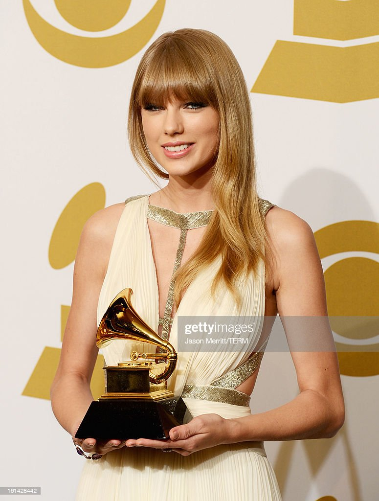 Singer/Musician Taylor Swift winner of Best Song Written For Visual Media poses in the press room at the 55th Annual GRAMMY Awards at Staples Center...