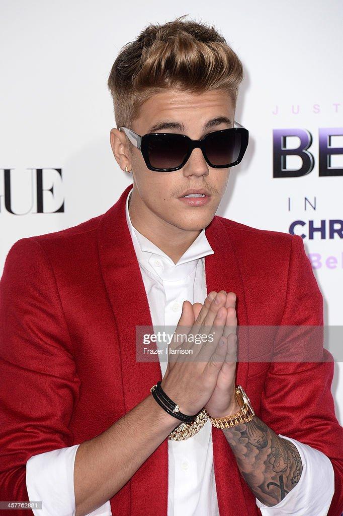 Singer/producer Justin Bieber arrives at the premiere of Open Road Films' 'Justin Bieber's Believe' at Regal Cinemas L.A. Live on December 18, 2013 in Los Angeles, California.