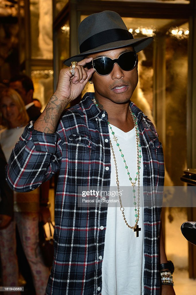 Singer/Producer Pharrell Williams attends the cocktail for the Moncler New Flagship Opening in Paris at Rue Du Faubourg Saint-Honore on September 26, 2013 in Paris, France.