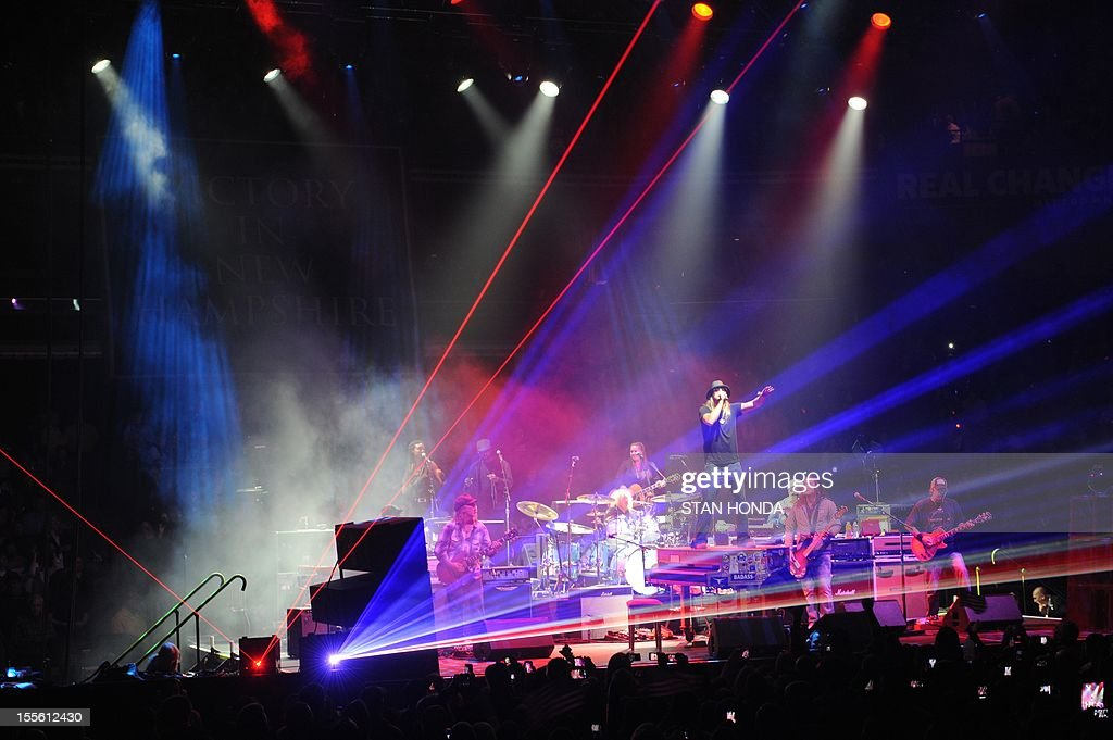 Singer/rapper Kid Rock (standing on piano) performs at a campaign rally for US Republican Presidential candidate Mitt Romney November 5, 2012 at the Verizon Wireless Arena in Manchester, New Hampshire. AFP PHOTO/Stan HONDA
