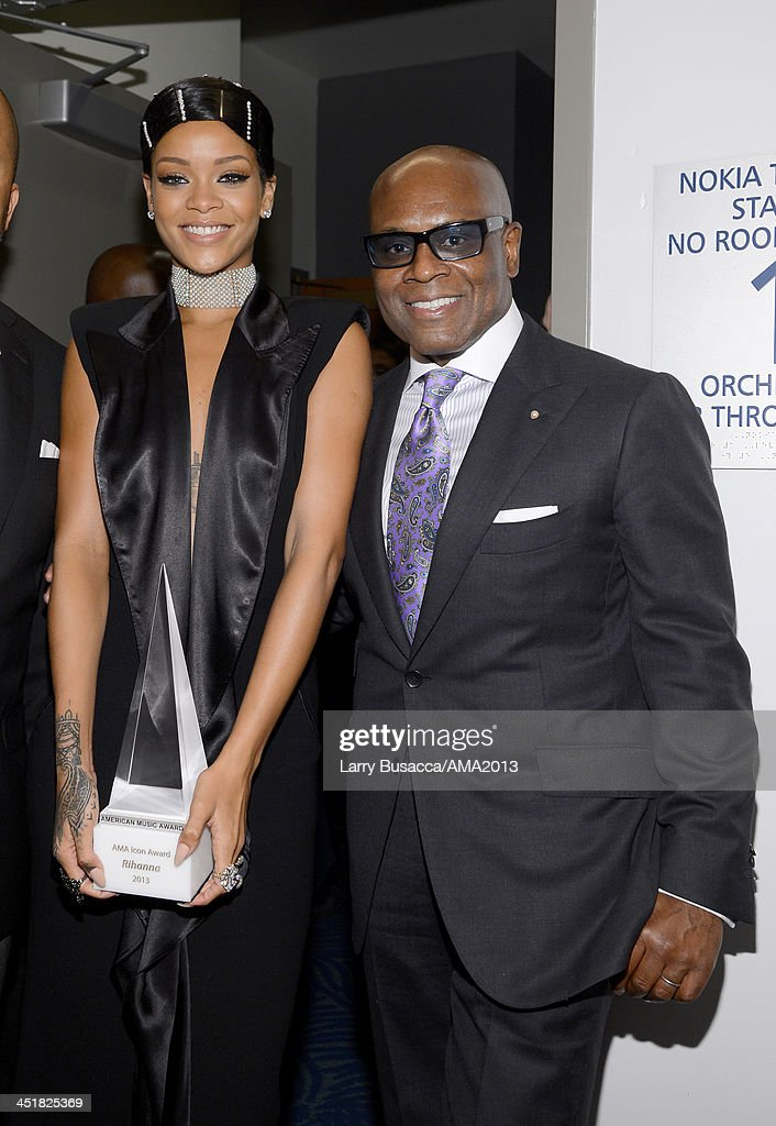 Singer/Recording Artist <a gi-track='captionPersonalityLinkClicked' href=/galleries/search?phrase=Rihanna&family=editorial&specificpeople=453439 ng-click='$event.stopPropagation()'>Rihanna</a>, recipient of the AMA Icon Award, and record producer Antonio 'L.A.' Reid pose backstage at the 2013 American Music Awards at Nokia Theatre L.A. Live on November 24, 2013 in Los Angeles, California.