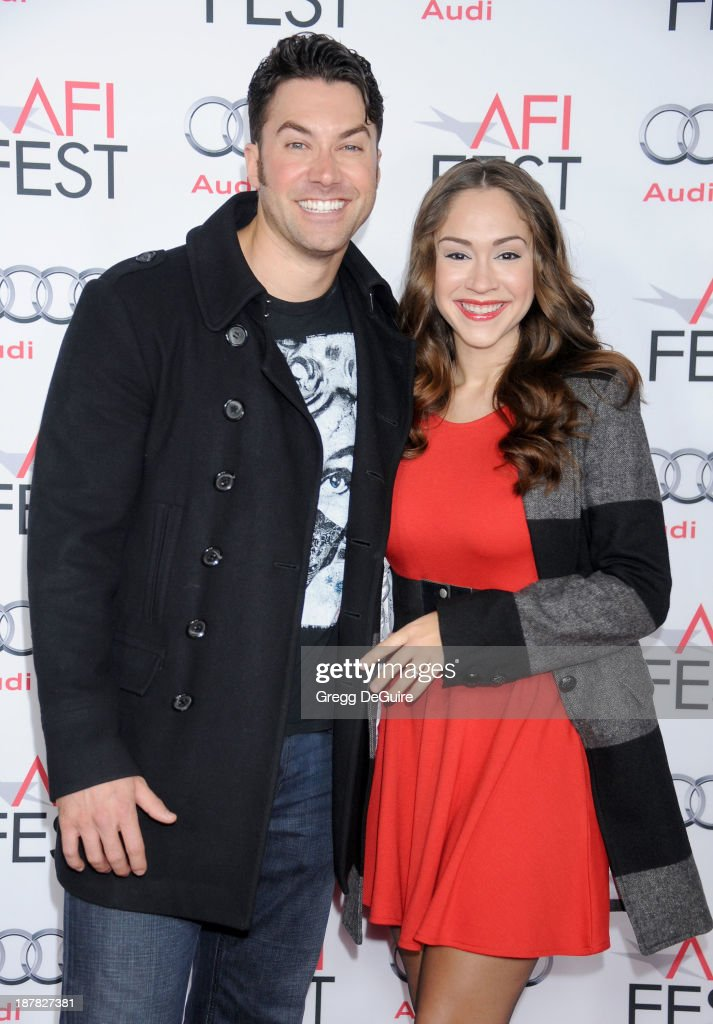 Singers Ace Young and Diana DeGarmo arrive at the AFI FEST 2013 for the 'Lone Survivor' premiere at TCL Chinese Theatre on November 12, 2013 in Hollywood, California.