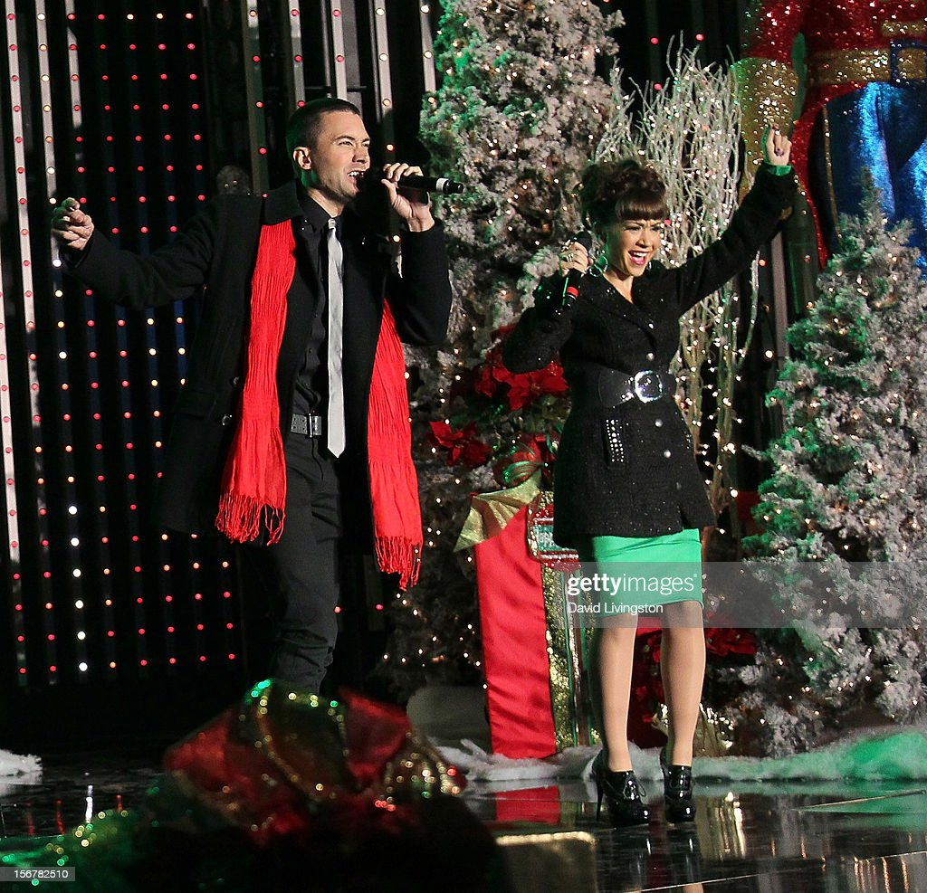 Singers Ace Young (L) and Diana DeGarmo perform on stage at Associated Television International's 2012 Hollywood Christmas Parade Concert at Universal CityWalk's 5 Towers on November 20, 2012 in Universal City, California.