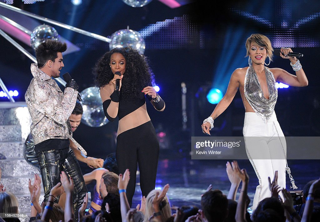 Singers Adam Lambert, Kelly Rowland and Keri Hilson perform onstage during 'VH1 Divas' 2012 at The Shrine Auditorium on December 16, 2012 in Los Angeles, California.