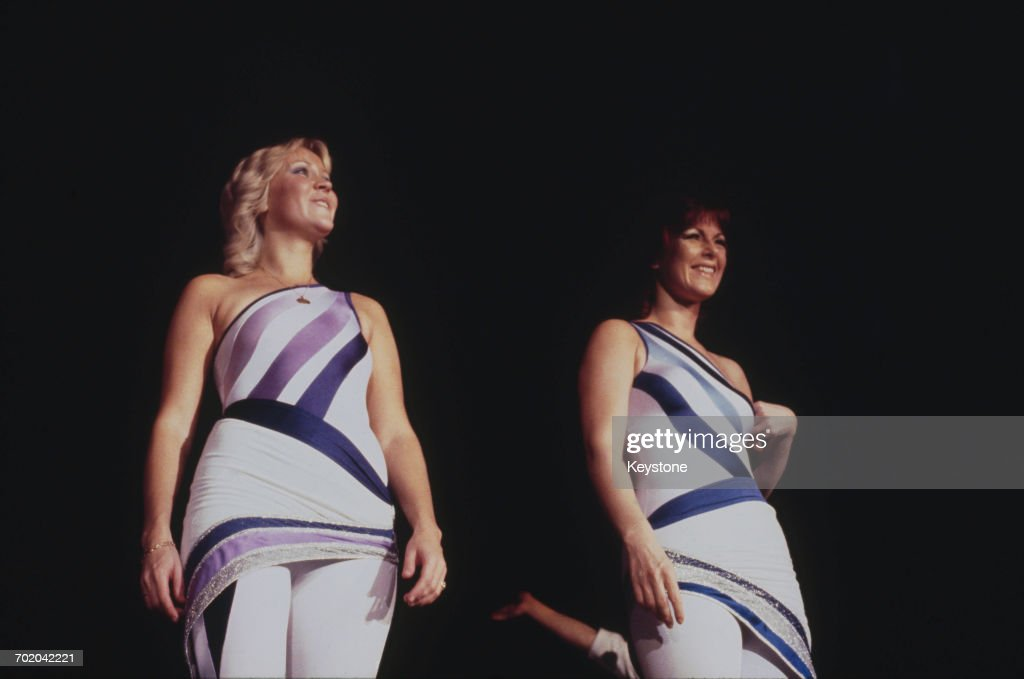 Singers Agnetha Fältskog (left) and Anni-Frid Lyngstad performing with Swedish pop group Abba on their third, and final, tour, 1979.