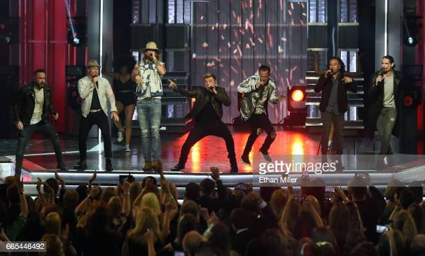 Singers AJ McLean and Brian Littrell of the Backstreet Boys recording artist Brian Kelley of Florida Georgia Line singer Nick Carter of the...