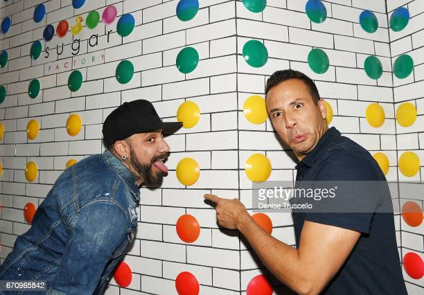 Singers AJ McLean and Howie Dorough of the Backstreet Boys attend the grand opening of Sugar Factory American Brasserie at the Fashion Show mall on...