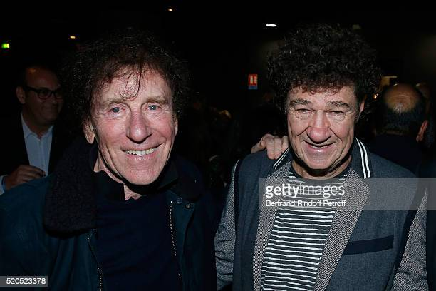 Singers Alain Souchon and Robert Charlebois pose after the Robert Charlebois '50 ans 50 chansons' Concert at Bobino on April 11 2016 in Paris France