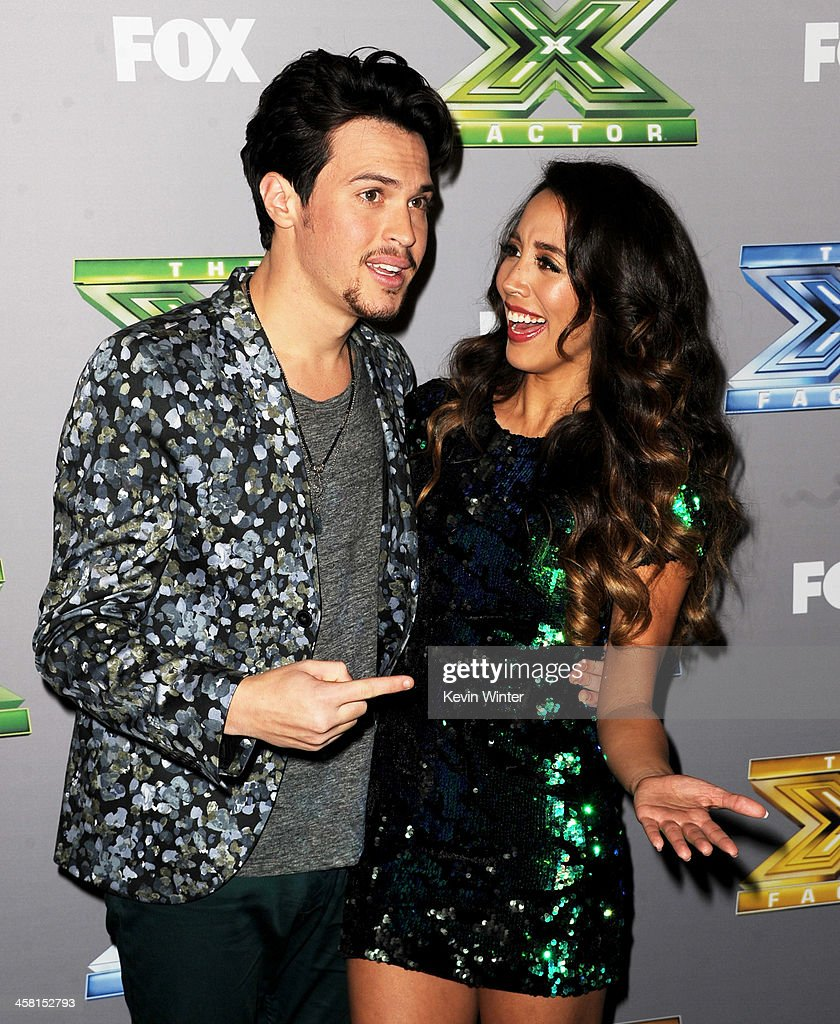 Singers Alex (L) and Sierra pose backstage after winning season three at Fox's 'The X Factor' Season Finale at CBS Television City on December 19, 2013 in Los Angeles, California.
