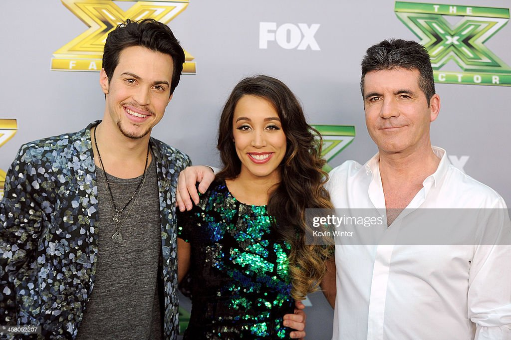 Singers Alex (L) and Sierra, with executive producer <a gi-track='captionPersonalityLinkClicked' href=/galleries/search?phrase=Simon+Cowell&family=editorial&specificpeople=203007 ng-click='$event.stopPropagation()'>Simon Cowell</a> (R) pose backstage after winning season three at Fox's 'The X Factor' Season Finale at CBS Television City on December 19, 2013 in Los Angeles, California.