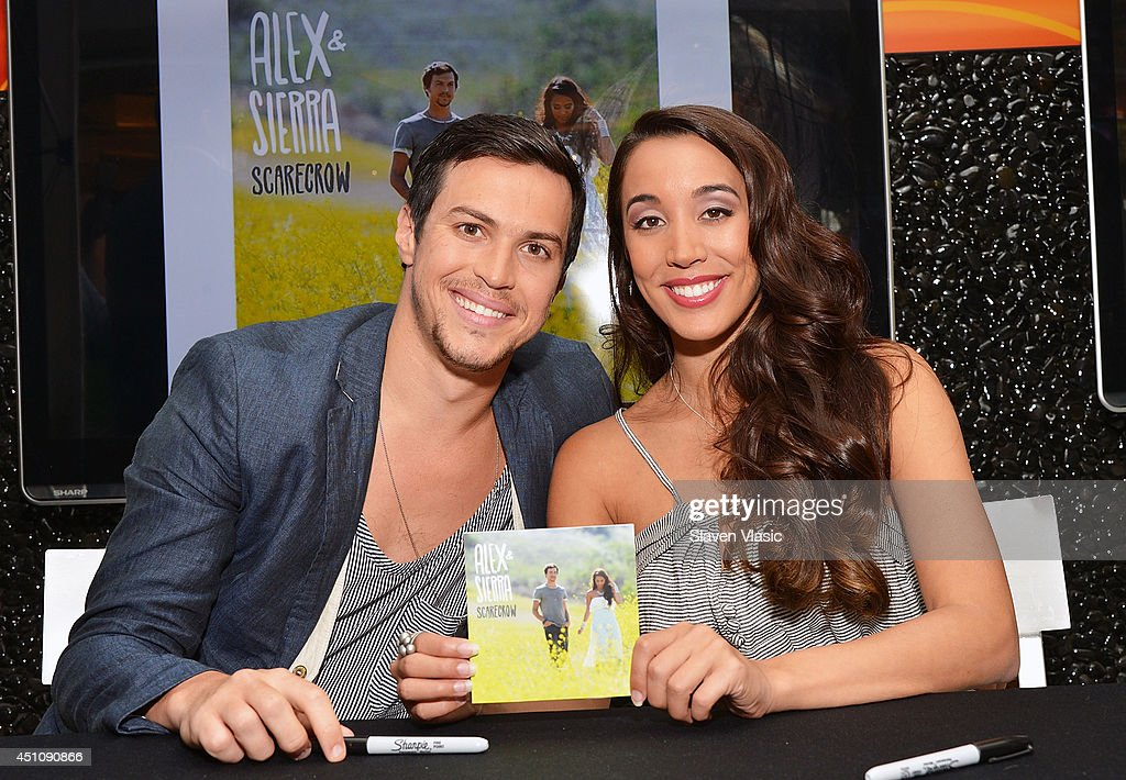 Singers <a gi-track='captionPersonalityLinkClicked' href=/galleries/search?phrase=Alex+Kinsey&family=editorial&specificpeople=3069908 ng-click='$event.stopPropagation()'>Alex Kinsey</a> (L) and <a gi-track='captionPersonalityLinkClicked' href=/galleries/search?phrase=Sierra+Deaton&family=editorial&specificpeople=11610502 ng-click='$event.stopPropagation()'>Sierra Deaton</a> of <a gi-track='captionPersonalityLinkClicked' href=/galleries/search?phrase=Alex+%26+Sierra&family=editorial&specificpeople=11540885 ng-click='$event.stopPropagation()'>Alex & Sierra</a> attend the Alex and Sierra 'Scarecrow' CD signing at NBC Experience Store on June 23, 2014 in New York City.
