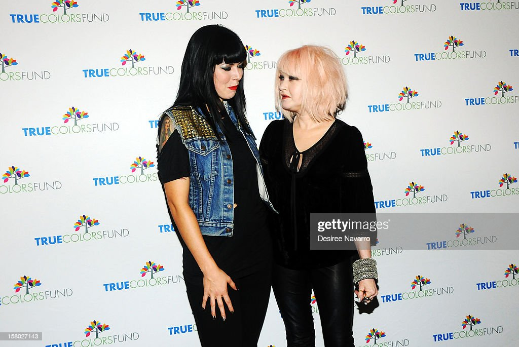 Singers <a gi-track='captionPersonalityLinkClicked' href=/galleries/search?phrase=Alexis+Krauss&family=editorial&specificpeople=6847527 ng-click='$event.stopPropagation()'>Alexis Krauss</a> of Sleigh Bells and (R) <a gi-track='captionPersonalityLinkClicked' href=/galleries/search?phrase=Cyndi+Lauper&family=editorial&specificpeople=171290 ng-click='$event.stopPropagation()'>Cyndi Lauper</a> attend the 2nd annual <a gi-track='captionPersonalityLinkClicked' href=/galleries/search?phrase=Cyndi+Lauper&family=editorial&specificpeople=171290 ng-click='$event.stopPropagation()'>Cyndi Lauper</a> and Friends: Home For The Holidays at The Beacon Theatre on December 8, 2012 in New York City.