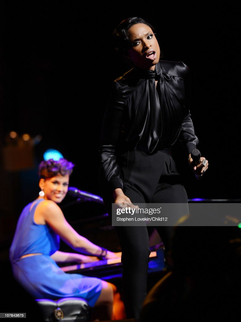 Singers <a gi-track='captionPersonalityLinkClicked' href=/galleries/search?phrase=Alicia+Keys&family=editorial&specificpeople=169877 ng-click='$event.stopPropagation()'>Alicia Keys</a> and <a gi-track='captionPersonalityLinkClicked' href=/galleries/search?phrase=Jennifer+Hudson&family=editorial&specificpeople=234833 ng-click='$event.stopPropagation()'>Jennifer Hudson</a> perform on stage during Black Ball Redux at The Apollo Theater on December 6, 2012 in New York City.