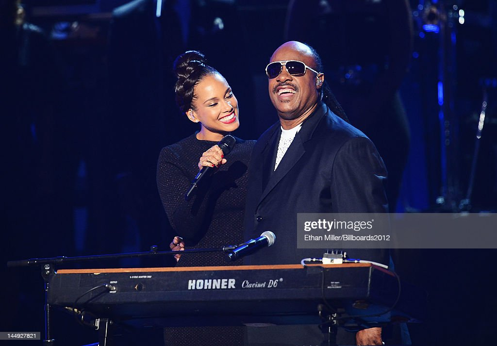 Singers <a gi-track='captionPersonalityLinkClicked' href=/galleries/search?phrase=Alicia+Keys&family=editorial&specificpeople=169877 ng-click='$event.stopPropagation()'>Alicia Keys</a> (L) and <a gi-track='captionPersonalityLinkClicked' href=/galleries/search?phrase=Stevie+Wonder&family=editorial&specificpeople=171911 ng-click='$event.stopPropagation()'>Stevie Wonder</a> perform onstage at the 2012 Billboard Music Awards held at the MGM Grand Garden Arena on May 20, 2012 in Las Vegas, Nevada.