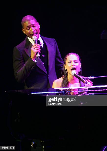 Singers Alicia Keys and Usher perform onstage at the Keep a Child Alive Annual Fundraiser 'The Black Ball' at Frederick P Rose Hall at Lincoln Center...