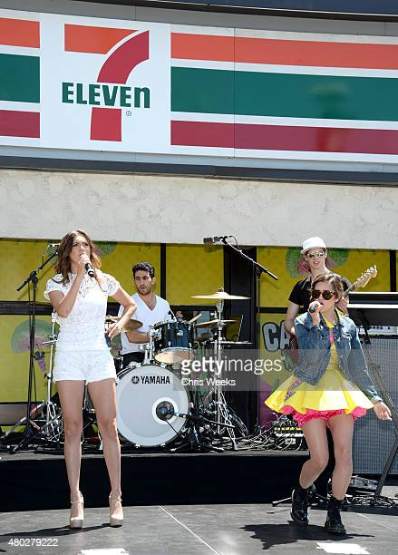Singers Alyson Stoner and Megan Nicole perform at the 7Eleven 88th birthday celebration at 7Eleven on July 10 2015 in Burbank California