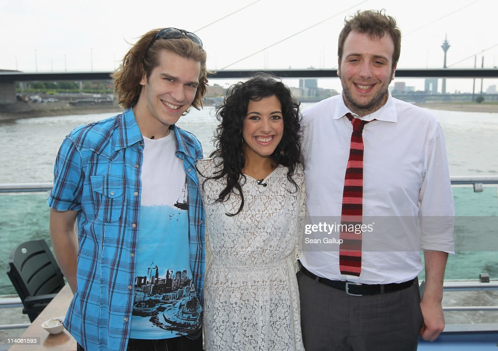 Singers Amaury Vassili of France, Lucia Perez of Spain and Raphael Gualazzi of Italy sail on a ship on the Rhine River during the Eurovision Song Contest 2011 on May 11, 2011 in Duesseldorf, Germany.