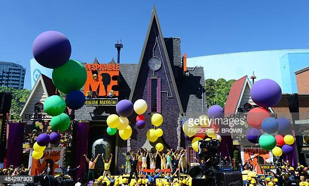 Singers and dancers perform to Pharrell William's 'Happy' during celebrations at Universal Studios marking the opening of its latest attraction...