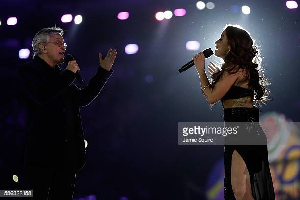 Singers Anitta and Caetano Veloso perform during the Opening Ceremony of the Rio 2016 Olympic Games at Maracana Stadium on August 5 2016 in Rio de...