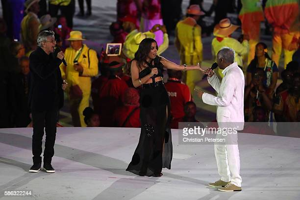 Singers Anitta Gilberto Gil and Caetano Veloso perform during the Opening Ceremony of the Rio 2016 Olympic Games at Maracana Stadium on August 5 2016...