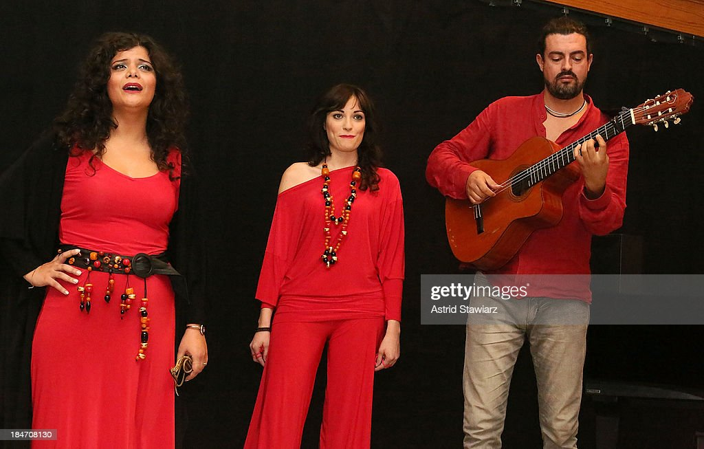 Singers Annalisa Madonna, Nicoletta Battelli and guitarist Gianni Migliaccio perform during the 'Voices Of Italy' press preview on October 15, 2013 in New York, United States.