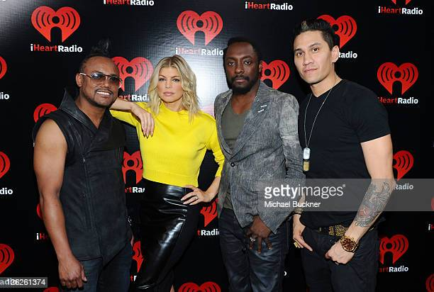 Singers apldeap Stacy 'Fergie' Ferguson WillIAm and Taboo of The Black Eyed Peas pose backstage at the iHeartRadio Music Festival held at the MGM...
