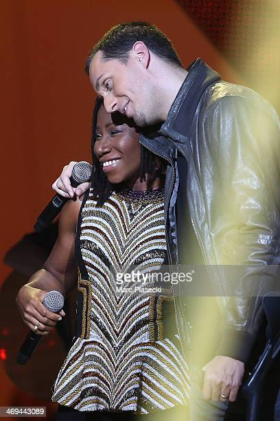 Singers ASA and 'Grand Corps Malade' perform during the 'Les Victoires de la musique 2014' ceremony at Le Zenith on February 14 2014 in Paris France