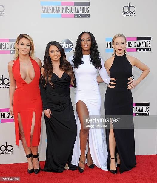 Singers Aubrey O'Day Aundrea Fimbres Dawn Richards and Shannon Bex of Danity Kane arrive at the 2013 American Music Awards at Nokia Theatre LA Live...