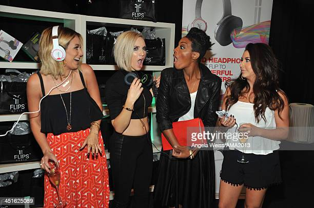 Singers Aubrey O'Day Shannon Bex Dawn Richards and Andrea Fimbres of Danity Kane attend day 2 of the 2013 American Music Awards gift lounge at Nokia...