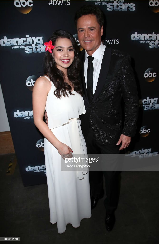 Singers Auli'i Cravalho (L) and Donny Osmond attend 'Dancing with the Stars' Season 24 at CBS Televison City on April 17, 2017 in Los Angeles, California.