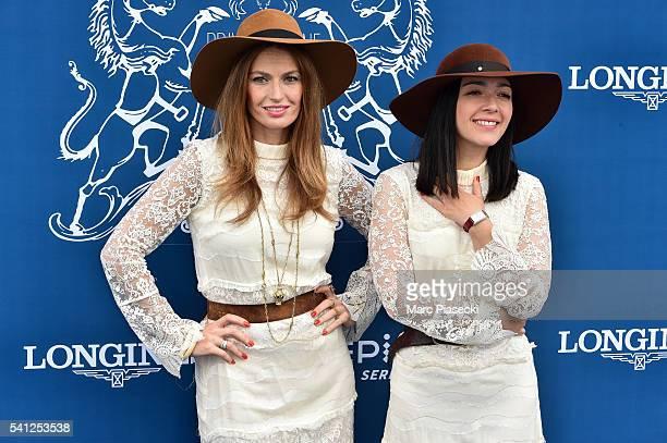 Singers Aurelie Saada and Sylvie Hoarau of 'Brigitte' attend the 'Prix de Diane Longines' on June 19 2016 in Chantilly France