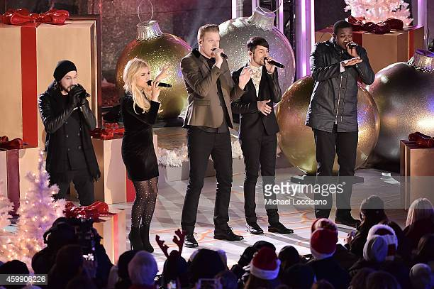 Singers Avi Kaplan Kirstie Maldonado Scott Hoying Mitch Grassi and Kevin Olusola of Pentatonix perform at the 82nd annual Rockefeller Christmas Tree...