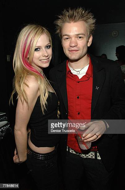 LAS VEGAS NOVEMBER 10 Singers Avril Lavigne and Deryck Whibley attend the Maroon 5 concert in the VIP Sky Lounge at The Pearl at The Palms Casino...