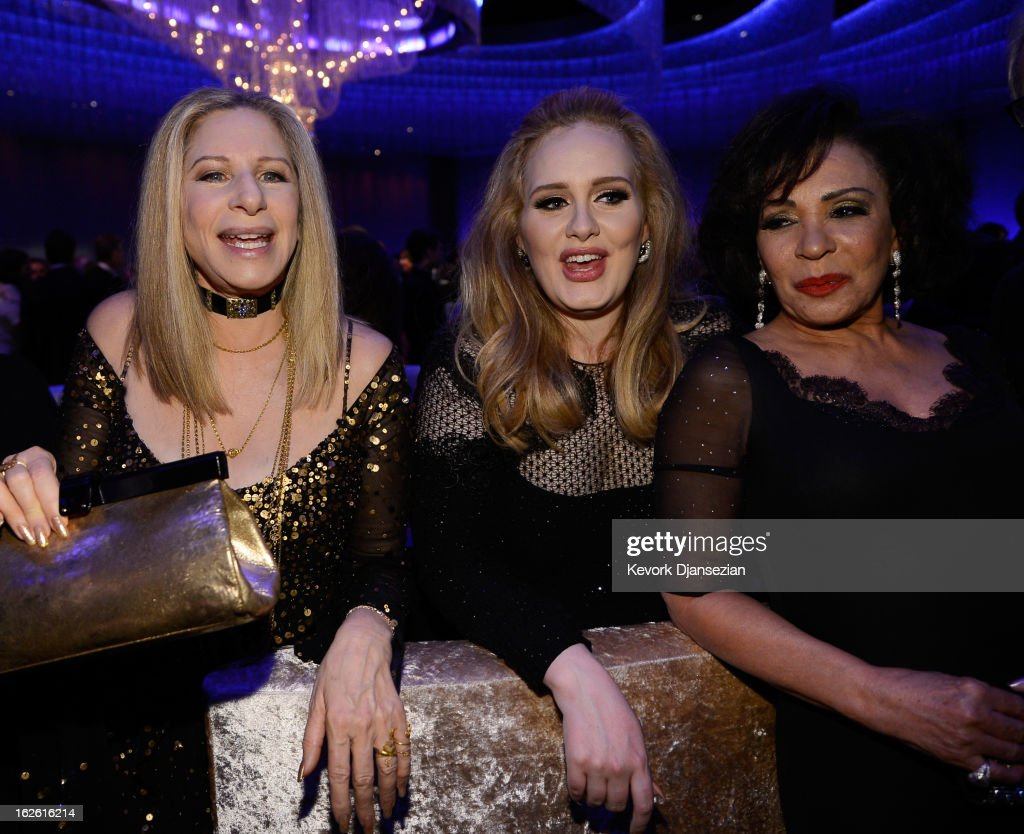 Singers Barbra Streisand Adele winner of the Best Original Song award for 'Skyfall' and Shirley Bassey attend the Oscars Governors Ball at Hollywood...