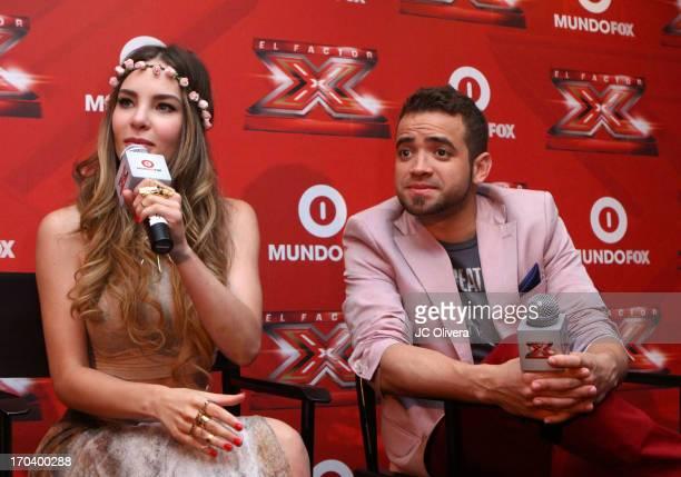 Singers Belinda and Miguel Ignacio Mendoza AKA Nacho from duo 'Chino y Nacho' speak during MundoFOX 'El Factor X' premiere and press conference at...
