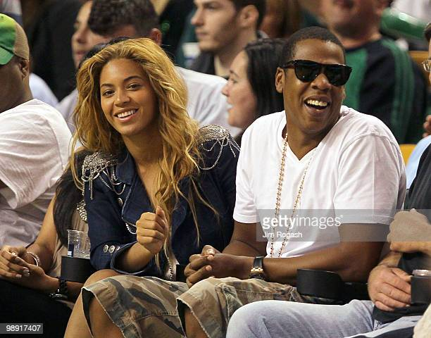 Singers Beyonce and JayZ sit courtside during a game between the Cleveland Cavaliers and the Boston Celtics during Game Three of the Eastern...
