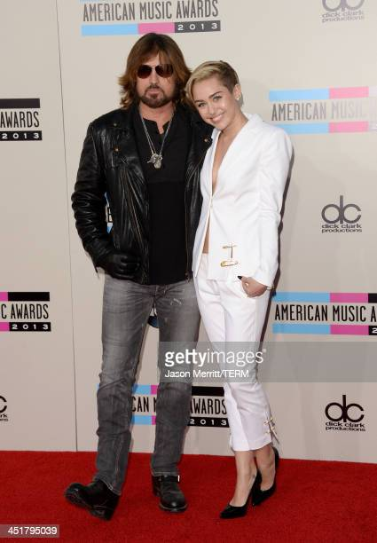 Singers Billy Ray Cyrus and daughter Miley Cyrus attend the 2013 American Music Awards at Nokia Theatre LA Live on November 24 2013 in Los Angeles...