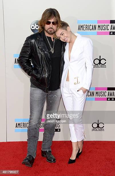 Singers Billy Ray Cyrus and Miley Cyrus attend the 2013 American Music Awards at Nokia Theatre LA Live on November 24 2013 in Los Angeles California