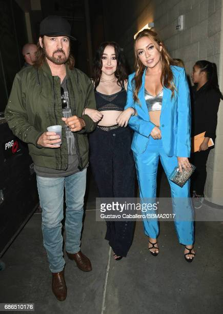 Singers Billy Ray Cyrus and Noah Cyrus and Brandi Cyrus attend the 2017 Billboard Music Awards at TMobile Arena on May 21 2017 in Las Vegas Nevada