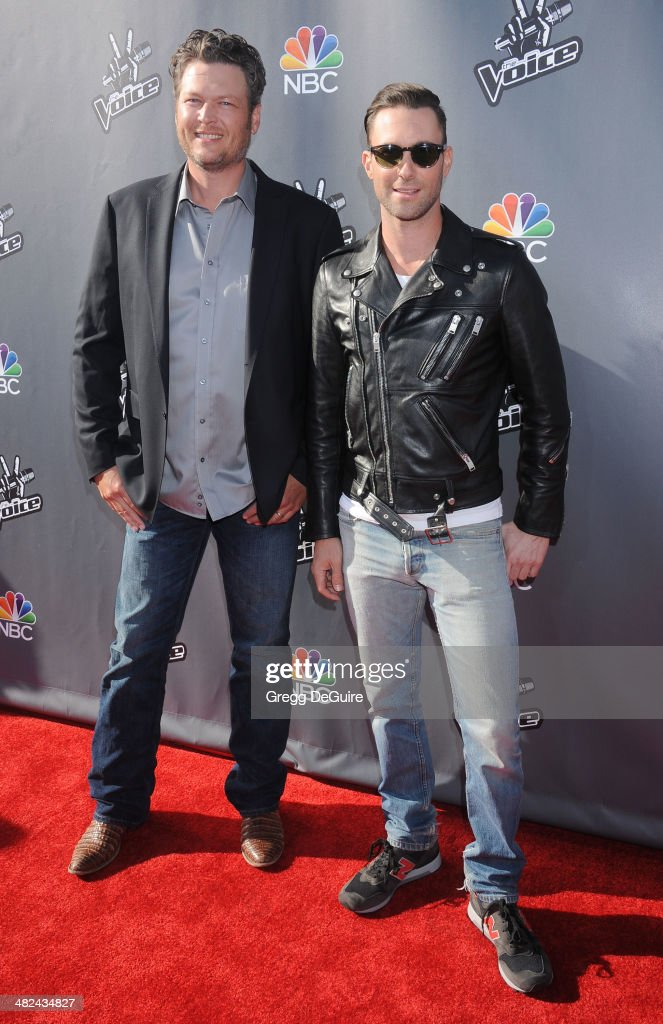 Singers Blake Shelton and Adam Levine arrive at NBC's 'The Voice' red carpet event at The Sayers Club on April 3, 2014 in Hollywood, California.